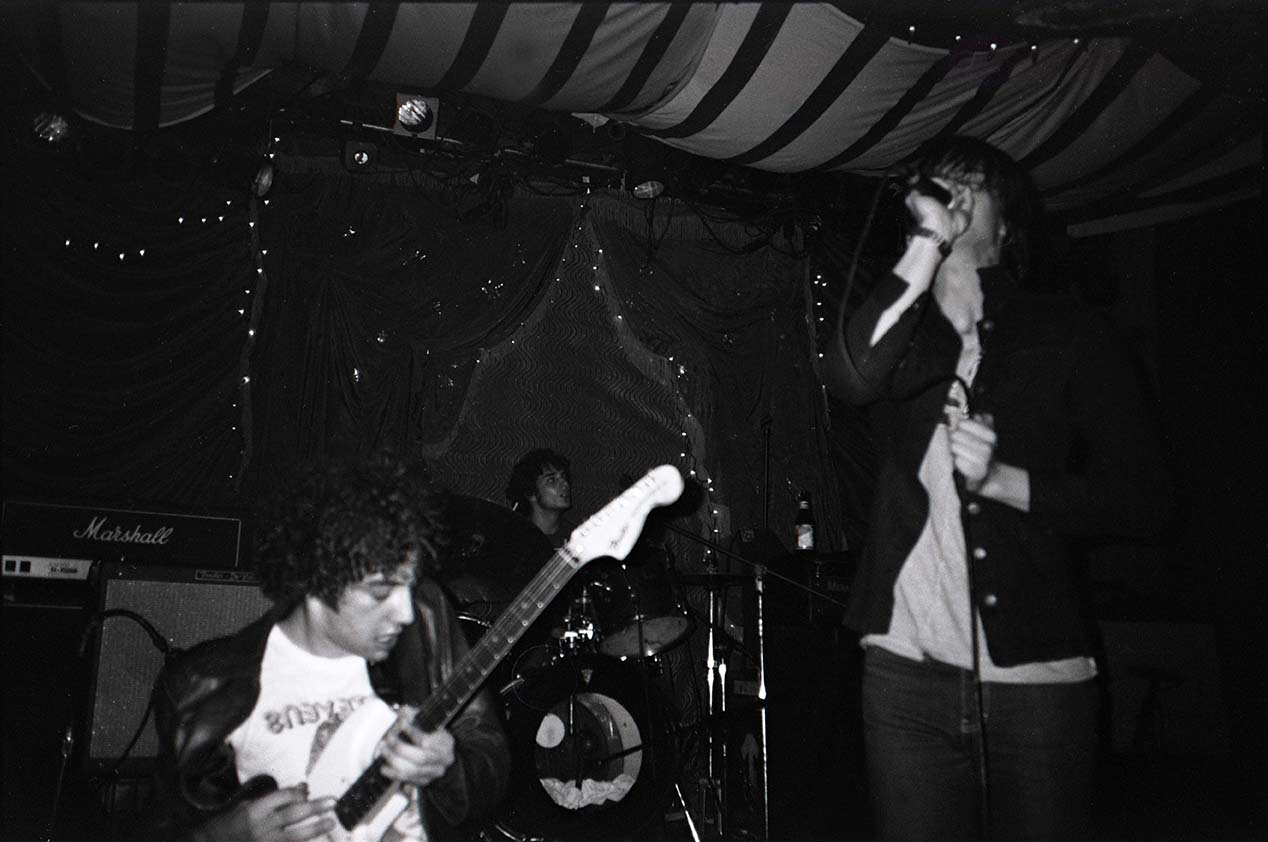 The Strokes playing live. Lead singer Julian Casablancas looking sharp.